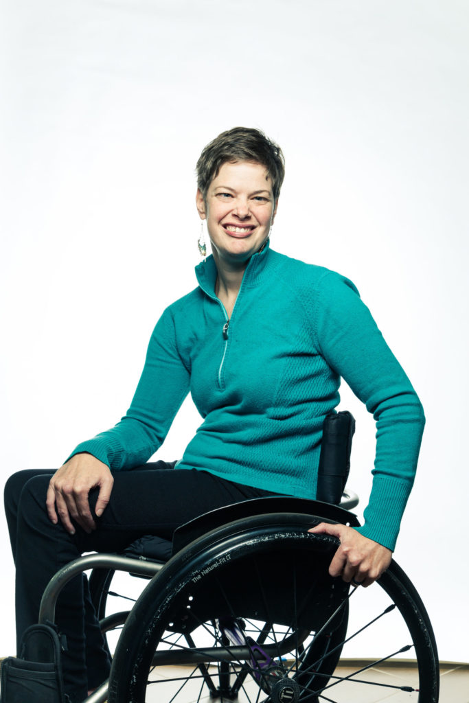Portrait of Meghan Sellet, director of TCNJ's Accessibility Resource Center. Meghan is seated in her wheelchair.